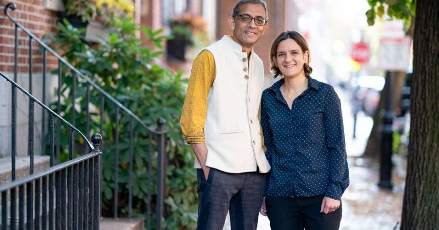 MIT economists Abhijit Banerjee and Esther Duflo stand outside their home after learning that they have been named co-winners of the 2019 Nobel Prize in economic sciences. They will share the prize with Michael Kremer of Harvard University.