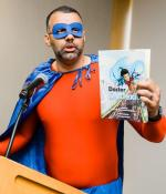 Shawn Robinson, senior research associate at the University of Wisconsin at Madison, helped kick off the first-ever MIT Science of Reading event dressed in full superhero attire as Doctor Dyslexia Dude — the star of a graphic novel series he co-created to engage and encourage young readers, rooted in his own experiences as a student with dyslexia.