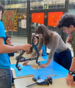In January 2020, MIT student Irene Terpstra (center, leaning over table) taught a week-long robotics workshop to 11th and 12th graders at CIC Escola de Batxillerats in Barcelona through the GTL Spain Program.